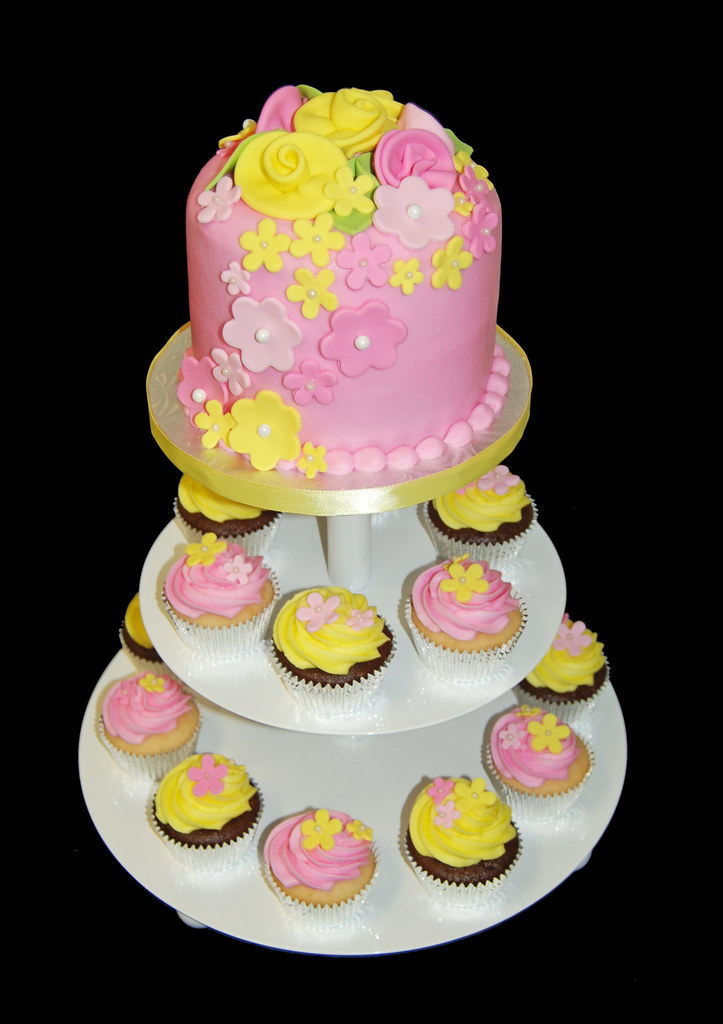 pink and yellow flower bridal shower cupcake tower by sweet shoppe mom and simply sweets