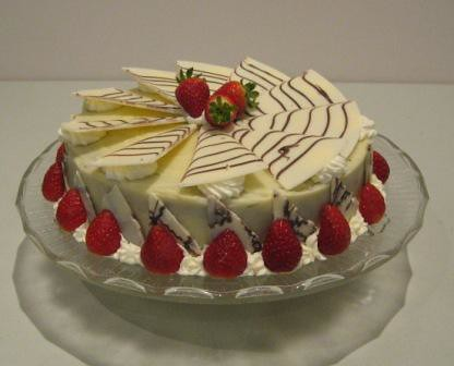 Chocolate Cake With Strawberries On Side With Powdred Sugar Pic