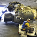 A helicopter is brought into USS Wasp.