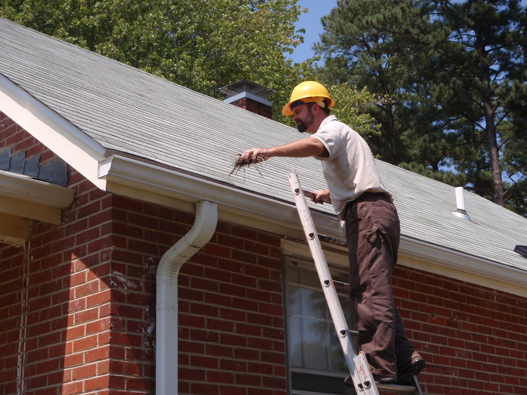 ... Cyrus Brame cleaning gutters - by U. S. Fish and Wildlife Service - Northeast Region