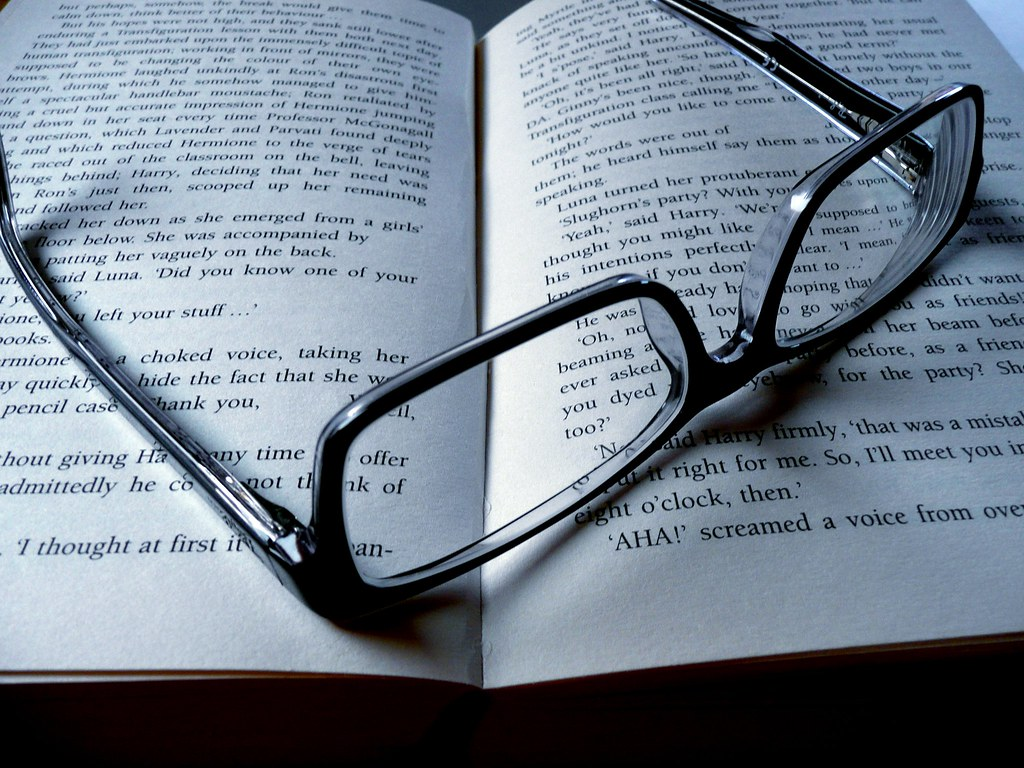 glasses on book - photo #7