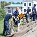 Sailors pack sandbags in preparation for Hurricane Irene