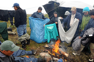 Drying clothes over the fire during a break in the storm | by Thelon River Expedition