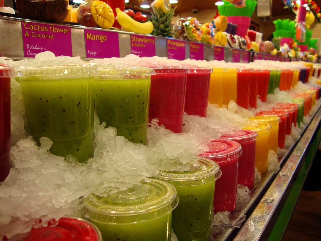 Colorful fruit drinks in the market in the La Rambla distr ...