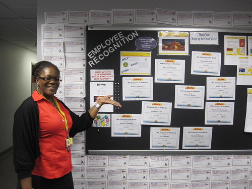 sharon showing us their employee recognition wall