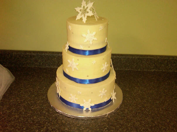 wedding cake with blue ribbon snowflake and royal blue ribbon wedding cake carrie 26829