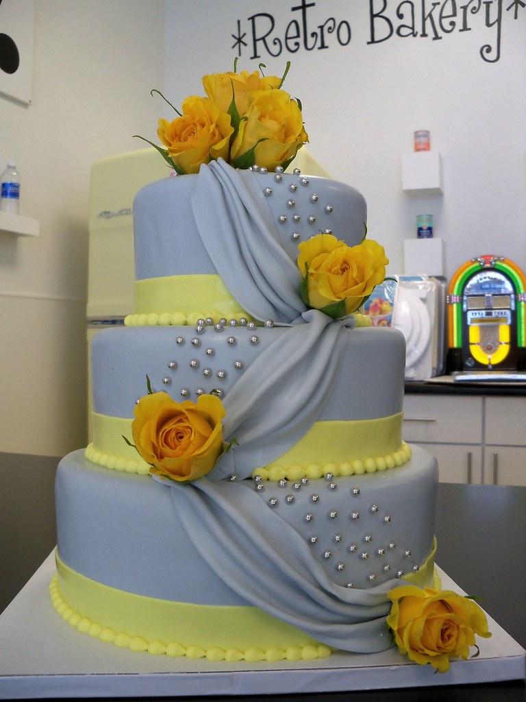 Grey and Yellow draped fondant wedding cake | Custom cakes R… | Flickr