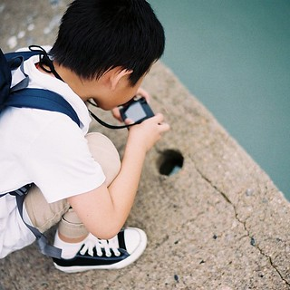 Olgua taking photo of a hole above water #hkinstayay #hkinstayay7 Voigtlander 35mm eFiniti 200 | by Patrick Ng