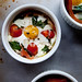 Baked Eggs with Sauteed Spinach, Cherry Tomatoes,  Goat Cheese and Proscuitto