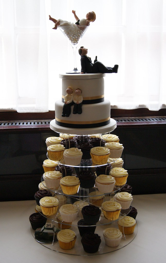 two tier cupcake wedding cake wedding cupcake tower with two tier top cake a simple 21336