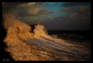 Golden Hour waves crashing up and over Porthcawl Pier | by Karen James