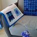 mod flower blues throw on sofa