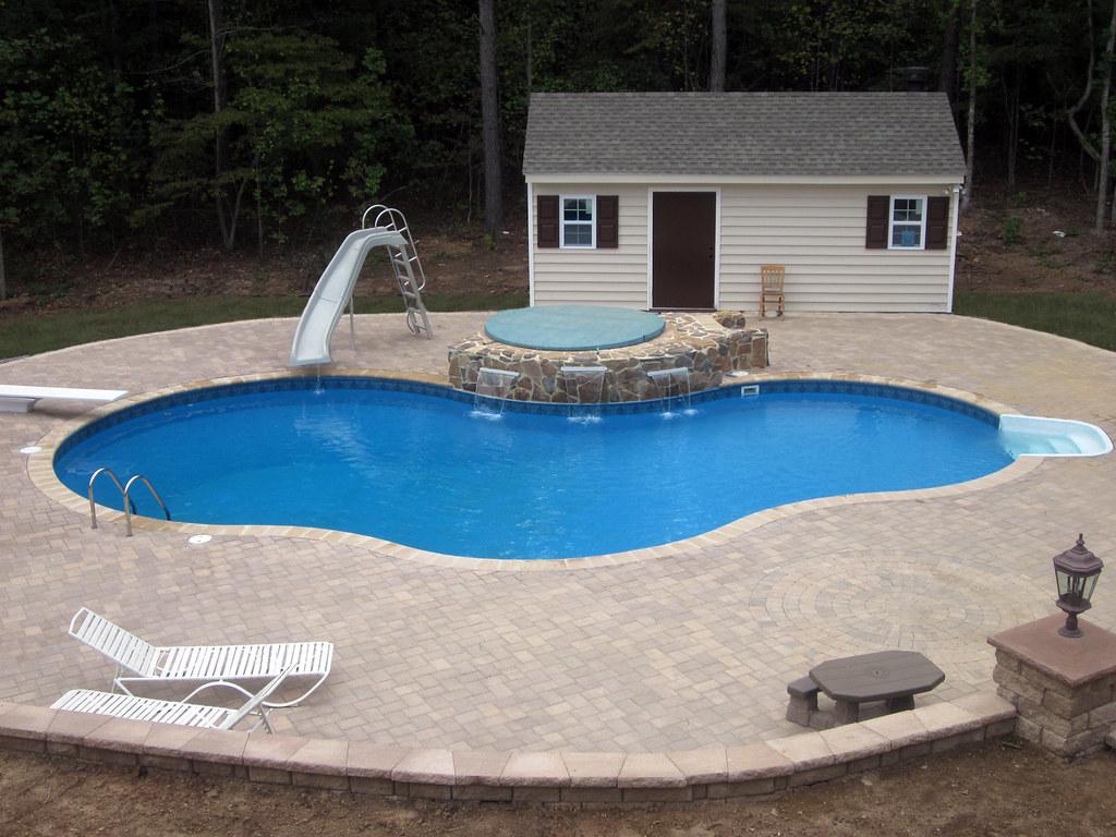 Inground swimming pool custom freeform paver deck 03 flickr for Swimming pool diving board paint kit