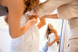 Bride Putting On Wedding Dress | by Kay Meyer Photo