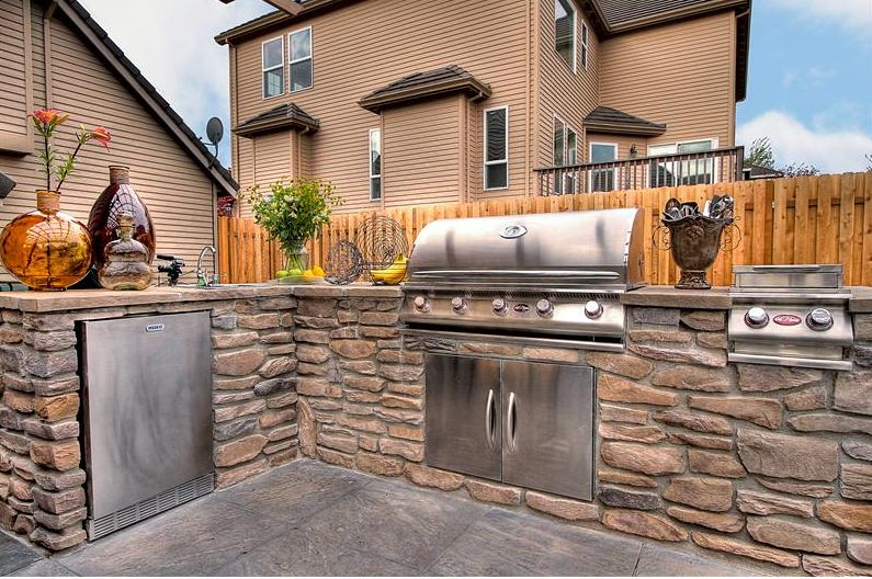 Custom outdoor kitchen by paradise restored landscaping for Outdoor kitchen cabinets plans