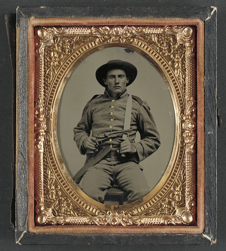 [Unidentified soldier in Confederate frock coat and slouch hat with Bowie knife and Colt Army Model 1860 revolver] (LOC) | by The Library of Congress