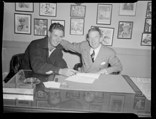 Ted Williams and Eddie Collins, signing contract | by Boston Public Library