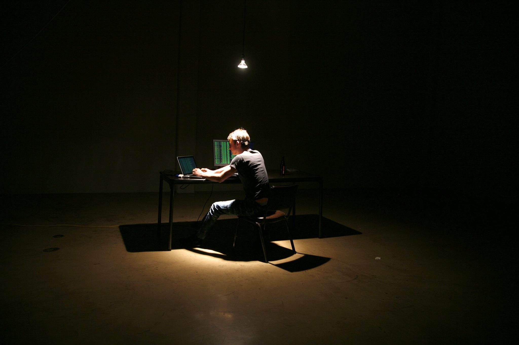Lone Hacker in Warehouse