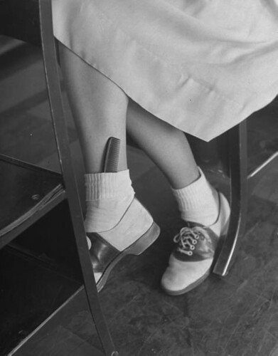teenaged girl June Runyon's legs and feet, wearing saddle shoes & bobby socks with a comb slipped in one of the cuffs, photo by Nina Leen 1947 | by sweetvintagegal