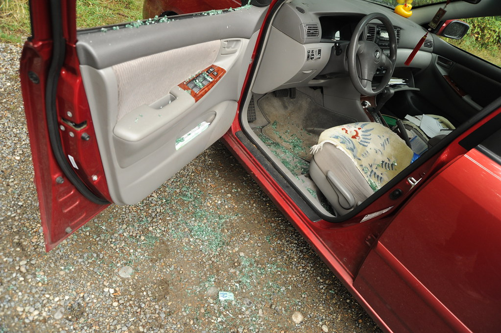 Driver side car break-in, Safeguard anti-theft notice with ...