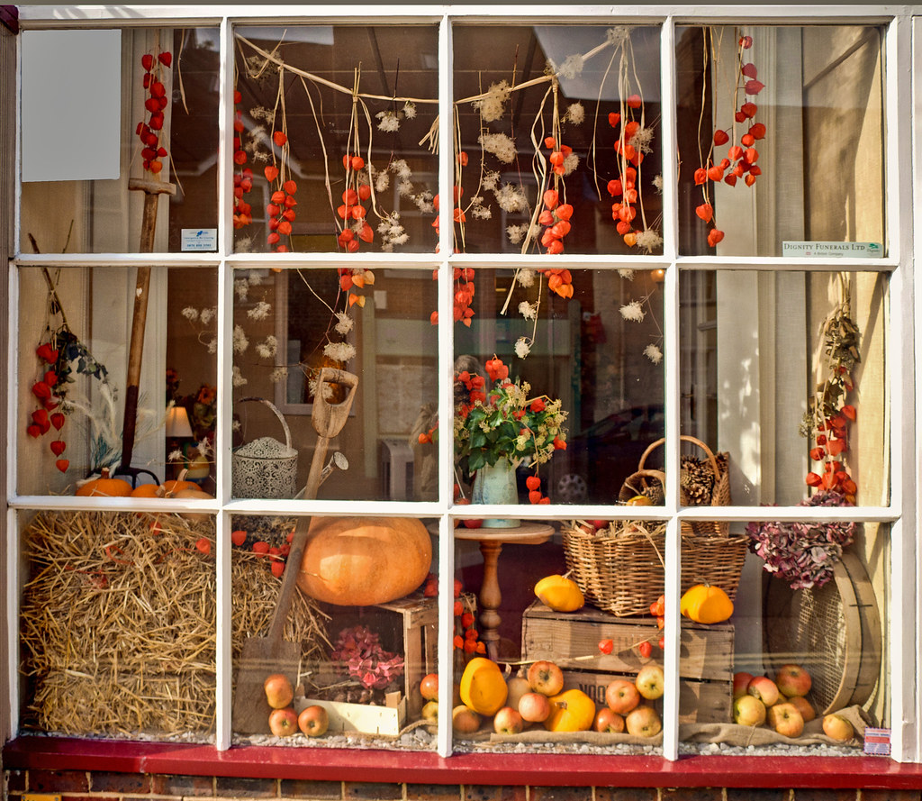An autumn harvest theme for a display in a shop window at for Retail christmas decorations ideas