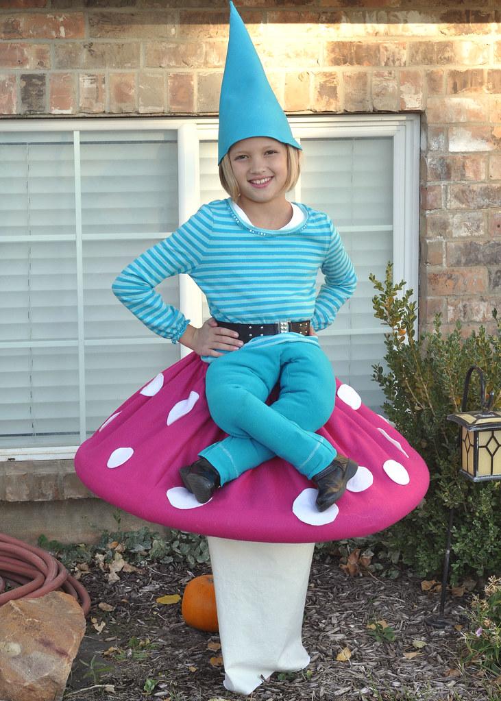 Pixie sitting on a mushroom costume