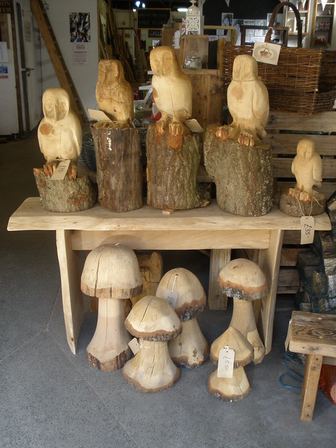 Handcarved and chainsaw carved mushrooms owls etc
