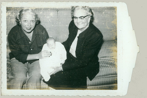 Polaroid baby with two women