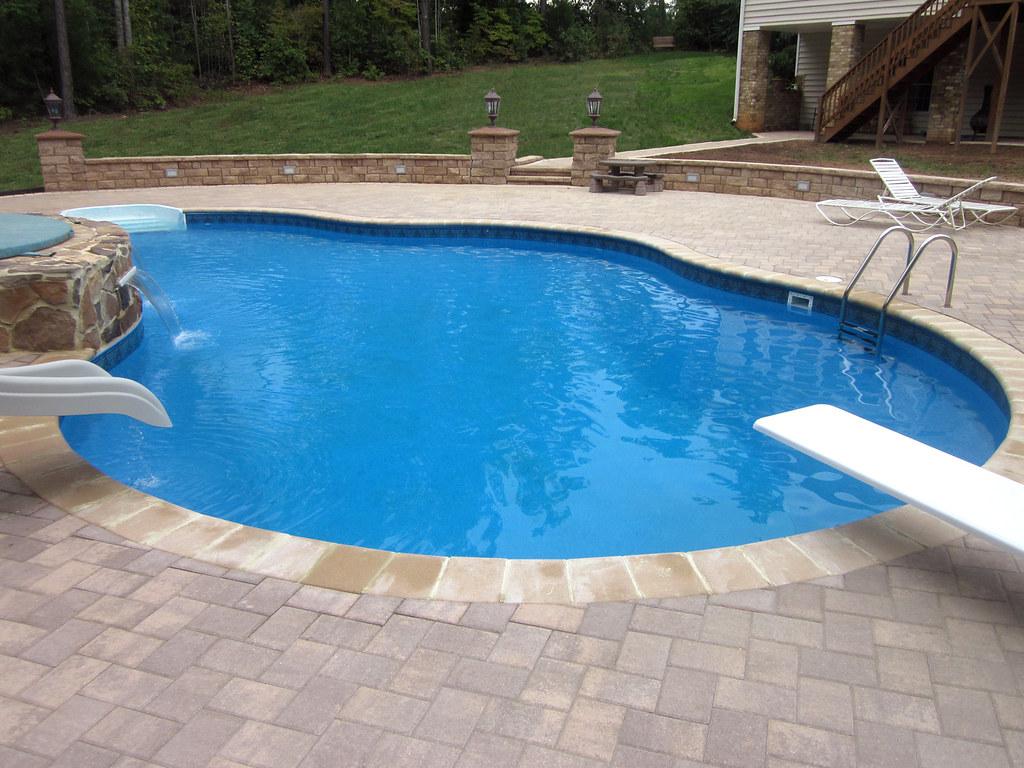 Inground swimming pool custom freeform paver deck 02 flickr for Walk in inground pool