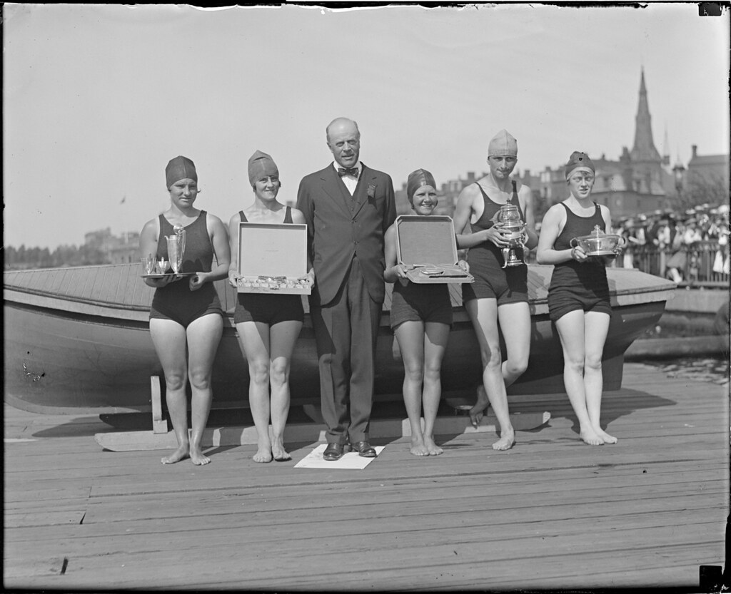 Women holding prizes at swimming competition | File name: 08