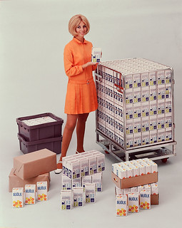 Tetra Pak® - Girl with Tetra Brik® packages - distribution system, 1960s | by Tetra Pak