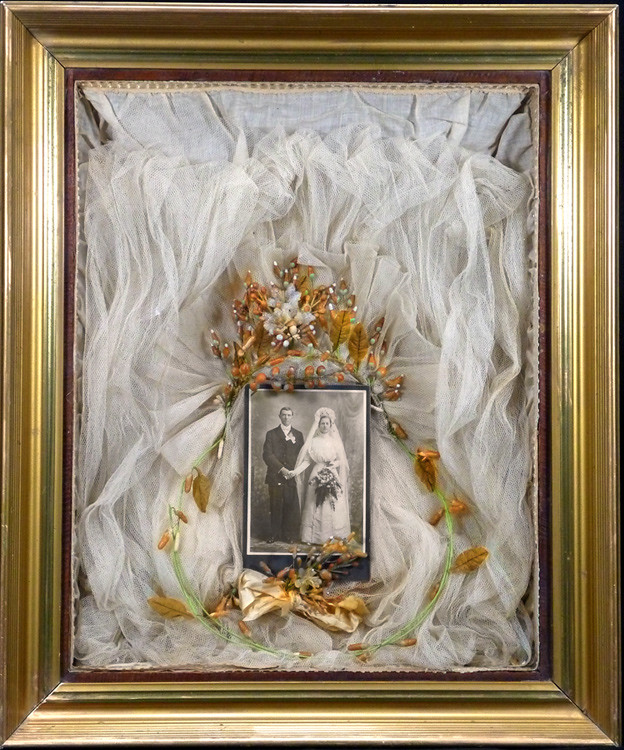 In November we attended a local antique show and bought a post card and a framed shadow box wedding memento. I posted the post card but the shadow box needed so