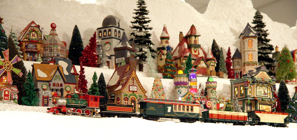 a train passing on christmas village mountain miniature electric train exhibits at the nixon presidential - Miniature Christmas Town Decorations