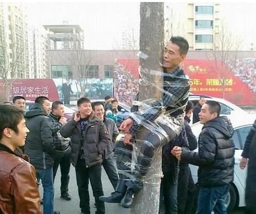 guy tied to tree