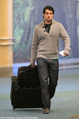 henry cavill - return from holiday - vancouver airport