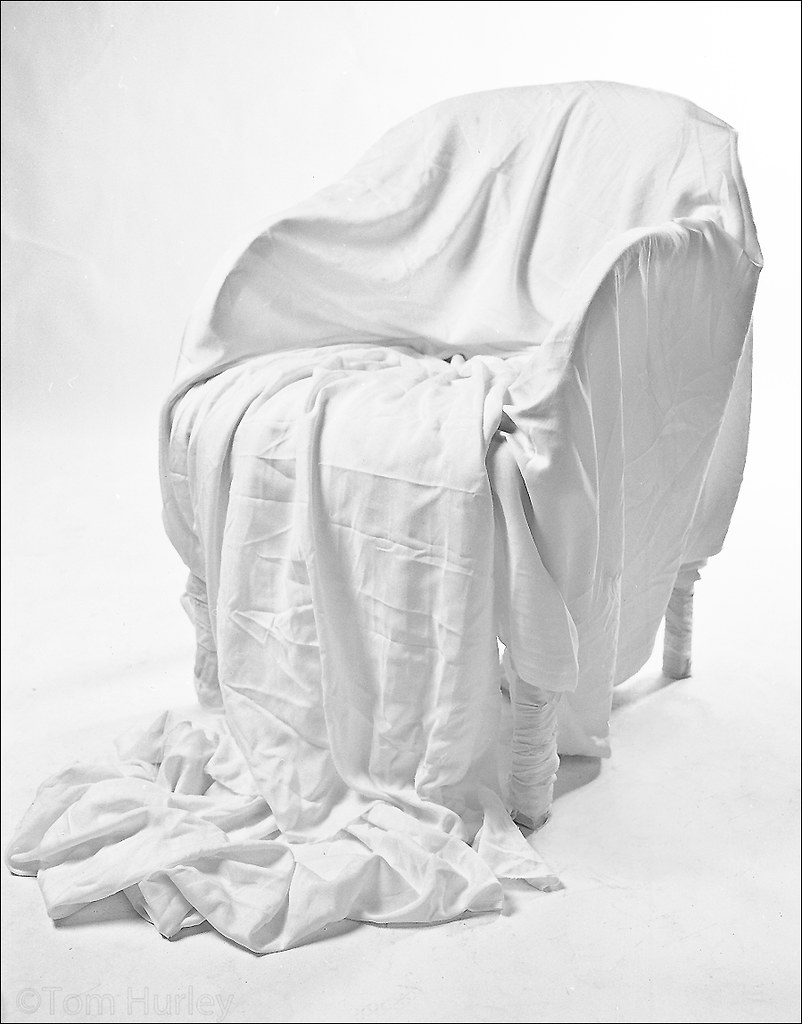 Genial Cloth Covered Chair | By Tom Hurley.