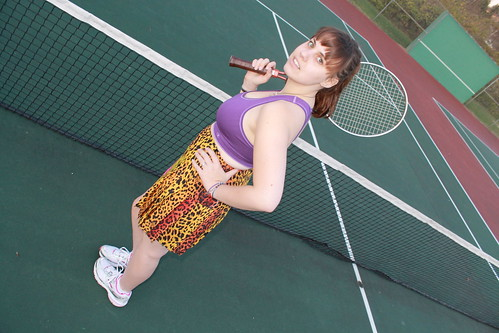 Tennis outfit: Versace for H&M silk pleated skirt, Brooks running shoes, Champion sports bra, vintage Wilson tennis racket | by Célèste of Fashion is Evolution