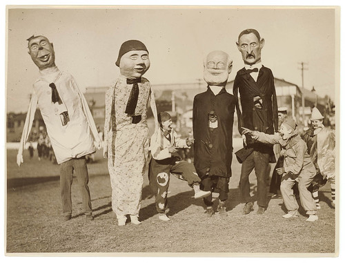 Clowns with people wearing large papier-mache carnival figures | by State Library of New South Wales collection