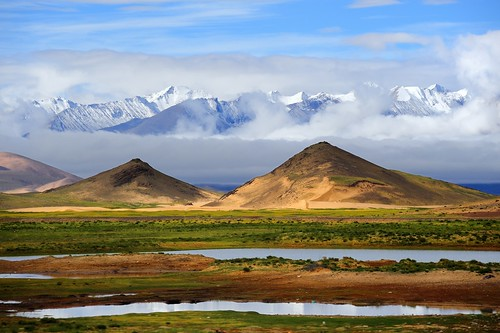 Ice peaks and desert sand dunes all visible in the Tibetan Himalayas | by reurinkjan