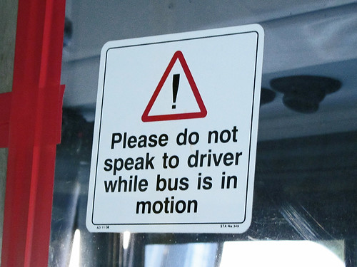"Plain English (sort of): ""Please do not speak to driver while bus is in motion"" 