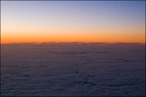 Sunset over the clouds from the plane | by Πichael C.