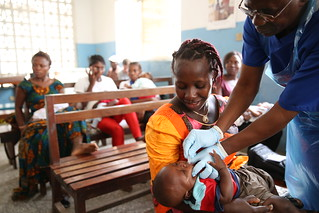 Isatu gets a vaccination for her 5 week old son | by World Bank Photo Collection