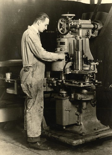 Adjusting Canco machine | by OSU Special Collections & Archives : Commons