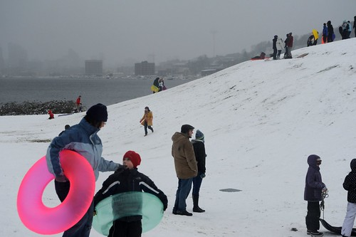 Mom and kid - Transparent pink and green sledding tubes, snow storm freedom day, city of Seattle, people at play, sledding, Gasworks Park, Wallingford, Seattle, Washington, USA | by Wonderlane