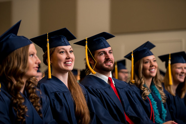 Students smile together at MNU commencement 2016