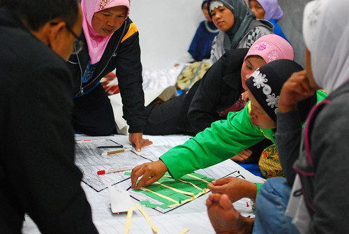 Community meeting discussing reconstruction of village hit by volcanic eruption | by World Bank Photo Collection