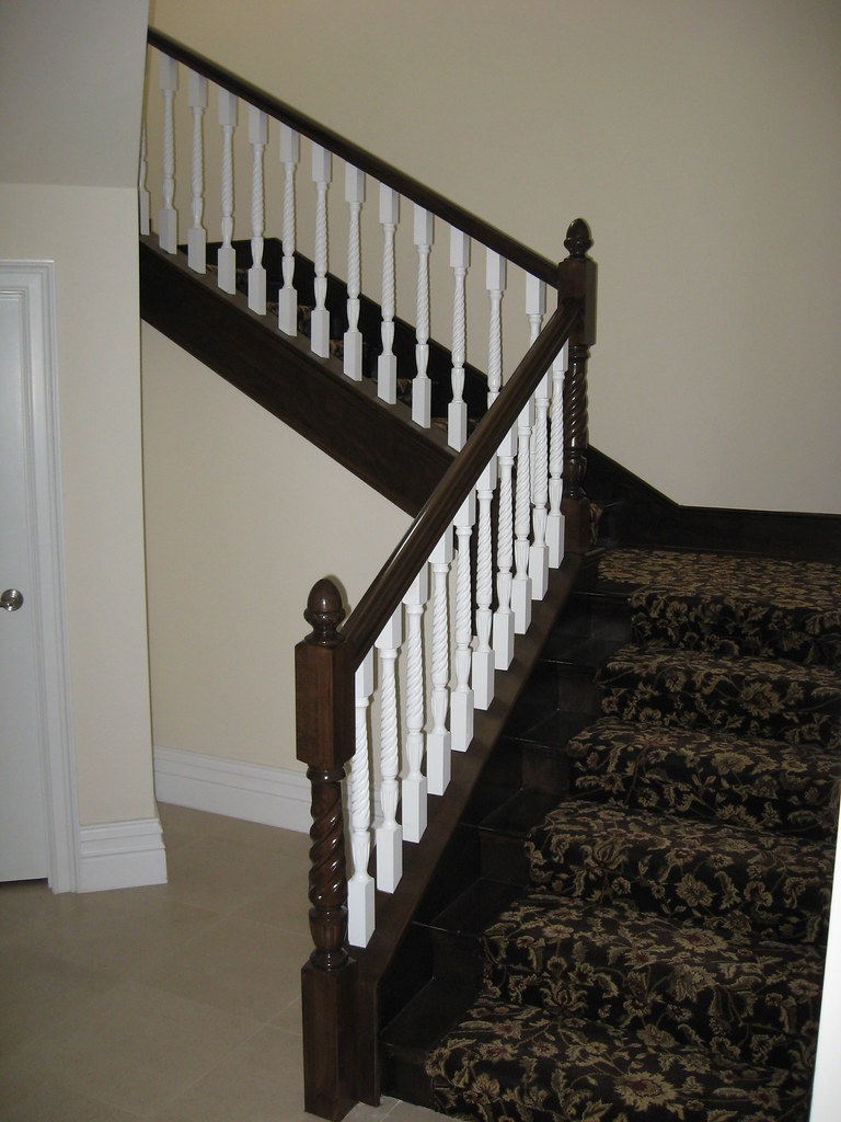 dark stained beech wood railing with white spindles skirt fl