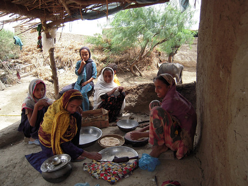 Young girls in the village of Sonu Khan Almani in Pakistan's Sindh province perform most of the household chores, like making bread. | Credit: Zofeen Ebrahim/IPS | by IPS Inter Press Service