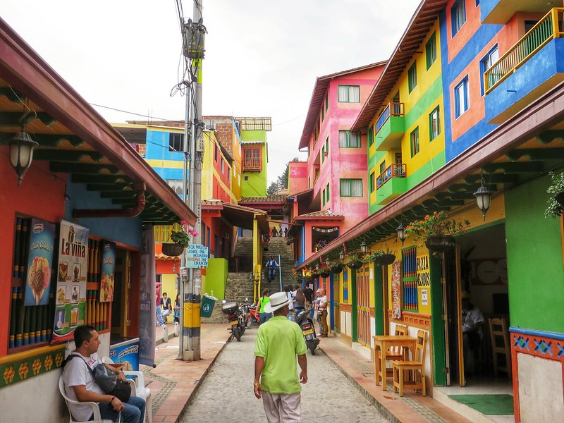 Walking through coloured buildings in Guatape