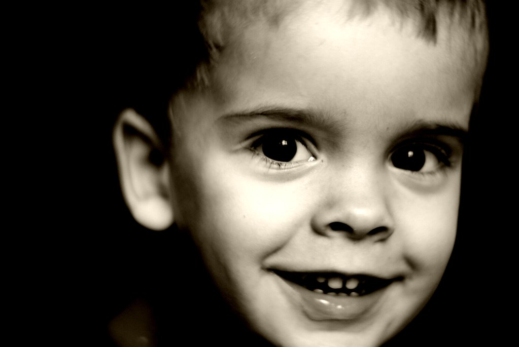 Young boy portrait black white by c mcbrien
